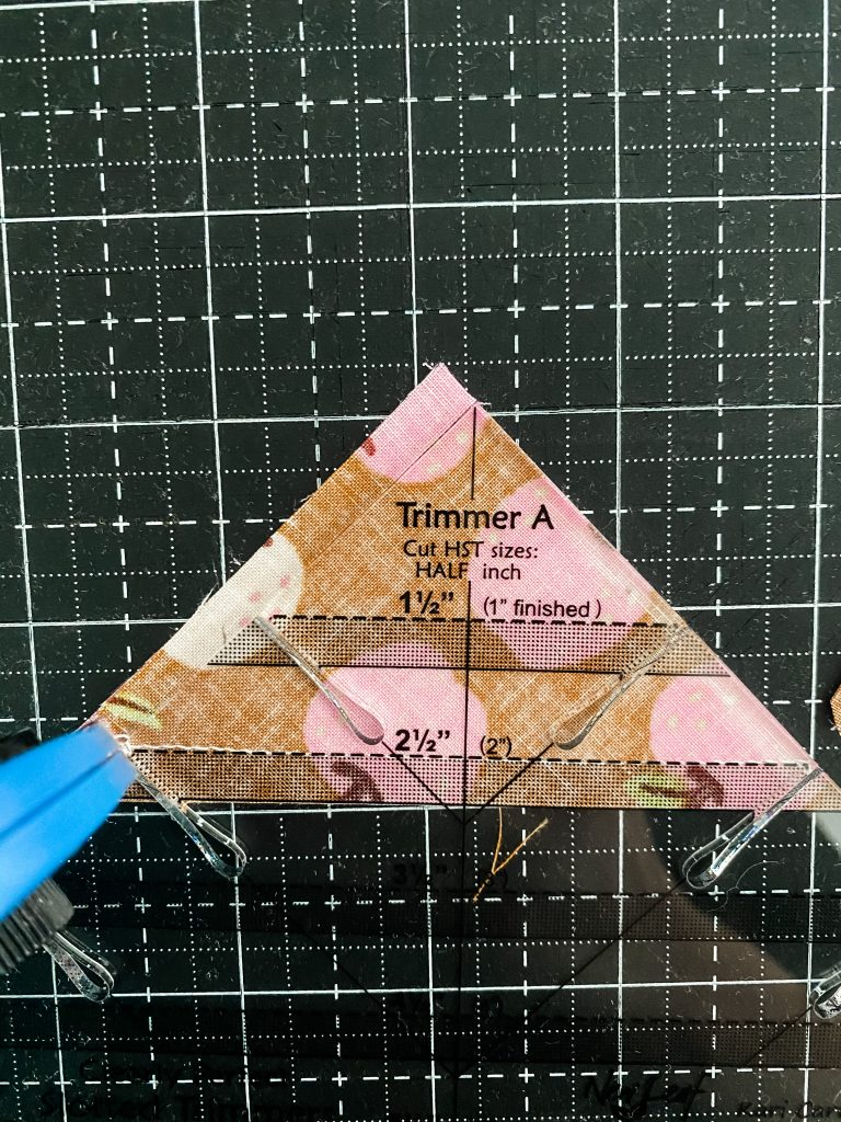 Using Slotted Trimmer to make a perfect Half Square Triangle